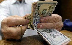 Dólar tem leve alta ante real na abertura, após recuar a R$3,10